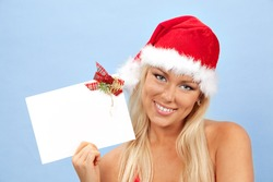 portrait of beautiful happy young christmas woman with empty greeting card