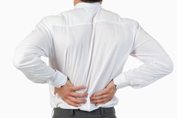 Painful back of a businessman against a white background