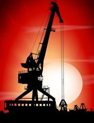 Silhouettes of port crane on a sunset