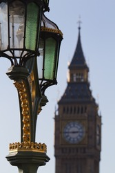 an antique street lamp on the Westminster bridge with the Big Ben in the background