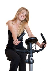 Woman training on exercise bike