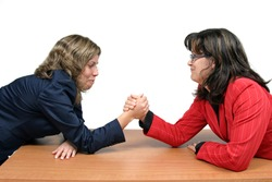 Two women arm wrestling at work on desk