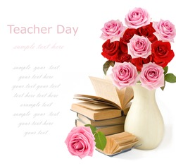 Teacher day (still life with bunch of pink and red roses and books isolated on white)