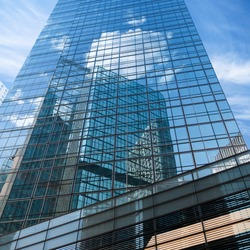 blue sky reflected in modern building mirror glass wall