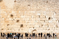 JERUSALEM, ISRAEL - JANUARY 23: Jewish worshipers pray at the Wailing Wall. The most holy site for Jews. January 23, 2011 in Jerusalem, Israel.