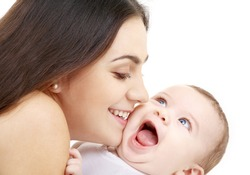 laughing baby playing with mother (focus on mama)