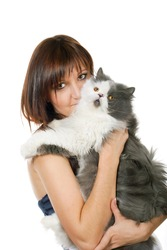 Charming young woman with persian cat isolated on white background