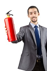Man with fire extinguisher in firefighting concept