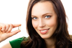 Portrait of young happy smiling woman showing Omega 3 fish oil capsule, isolated over white background