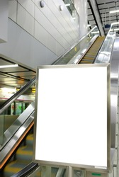 One big vertical / portrait orientation blank billboard with escalator background