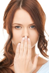 bright closeup picture of woman with hand over mouth