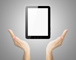 Two hand holding touch screen tablet on gray background