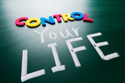 Control your life, colorful conceptual words on blackboard.