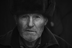 Black and white portrait of an old man.