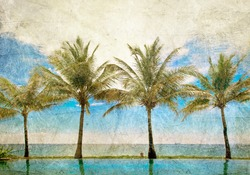 reflections of palms in the pool under blue sky in retro style