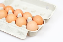 Fresh eggs in carton box on white background