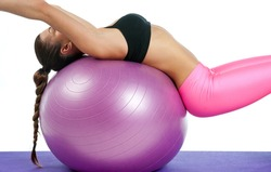 attractive fit woman on the pilates ball detail