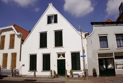 A historic white house in a village in the Netherlands