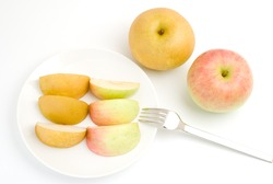 Apple and sand pear with fork on a white background