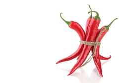 Red hot chili peppers tied with rope isolated on white