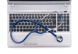 Stethoscope resting on a computer keyboard On line medicine concept