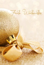 christmas card with christmas bauble and german frohe Weihnachten