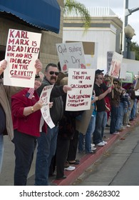 REDLANDS, CA - APRIL 15 : Protesters carry placards during tea party protest April 15, 2009 in Redlands, CA. The protest is a modern-day protest to the government's spending of billions of dollars.