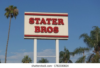 Redlands, CA / USA - July 12, 2020: Sign for Stater Bros chain against blue sky and palm trees