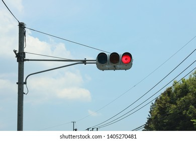 a red-lighted traffic light one