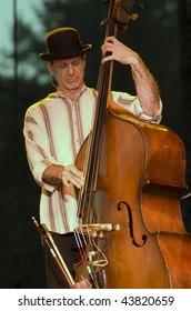 REDMOND, WA - AUG 11: Bass player Mark Schatz of Nickel Creek performs on stage at Marymoor Amphitheater August 11, 2006 in Redmond, Wa.
