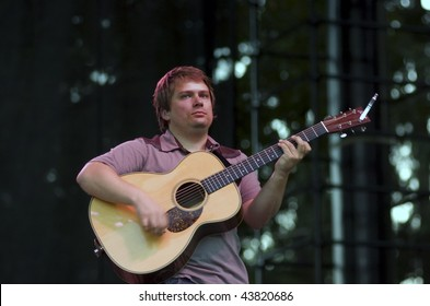 REDMOND, WA - AUG 11: Singer and guitar player Sean Watkins of Nickel Creek performs on stage at Marymoor Amphitheater August 11, 2006 in Redmond, Wa.