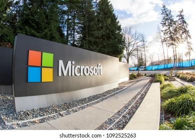 Redmond, WA, USA - January 30, 2018: Microsoft sign next to green trees at a public intersection near Microsoft's corporate headquarters at Washington campus