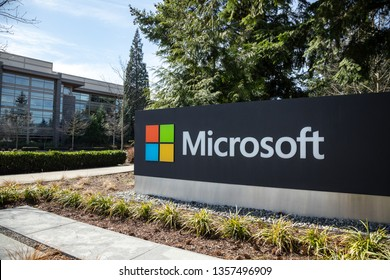 Redmond, Washington / USA - March 28 2019: Microsoft sign at the headquarters for the cloud computer and software company, with office building in the background and space for text
