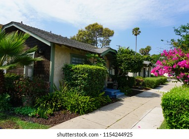 Redondo Beach, California USA - August 10, 2018: Individual cottage units on a central courtyard of a Los Angeles area bungalow court in Craftsman style architecture with wood shingle and stucco walls