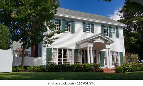 Redondo Beach, California USA -August 29, 2018: Front view of the historic Sweetser House shows the entrance portico and traditional Colonial Revival architectural details like window shutters.