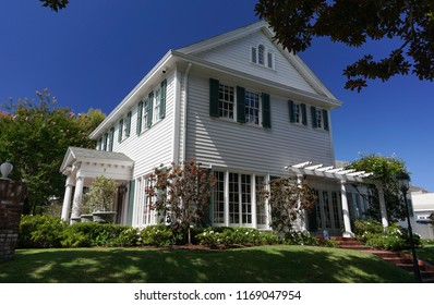 Redondo Beach, California USA -August 29, 2018: Front and east side of the Colonial Revival Sweetser House from 1921 shows the traditional architecture including entrance portico and shuttered windows
