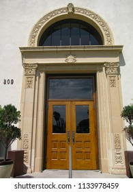 Redondo Beach, California USA - July 11, 2018: Entrance archway and front doorway of the historic public library building from 1930 near Redondo Beach pier south of Los Angeles