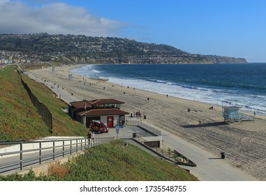 REDONDO BEACH, CA/USA - May 18, 2020: As Los Angeles county beaches partially reopen to the public, people flock to the shore for some sunshine and fresh air.