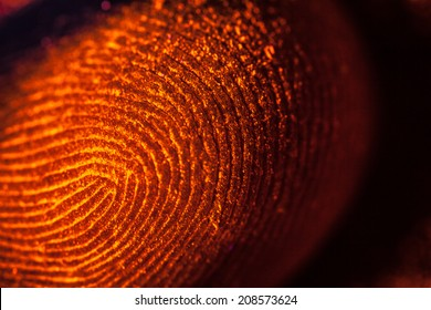 red-orange fingerprints on black, unfocused