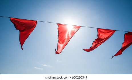 Reds flags waving in a sunny day