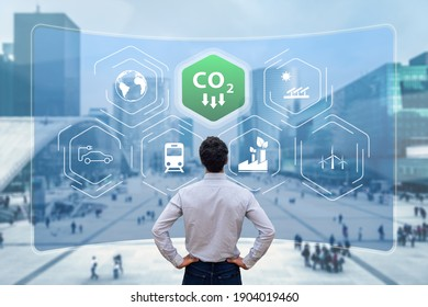 Reduce Carbon Dioxide Emissions to Limit Global Warming and Climate Change. Commitment to Paris Agreement to Lower CO2 levels with Sustainable Development as Renewable Energy and Electric Vehicles - Shutterstock ID 1904019460