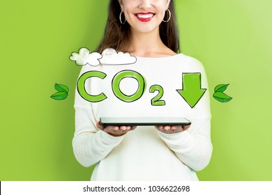 Reduce CO2 with woman holding a tablet computer