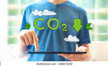 Reduce CO2 with young man using a tablet computer