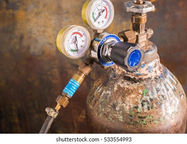 Reducer with pressure gauges  on the oxygen  tank, By attaching a device to prevent the fire back into the tank.Flashback arrestor for regulator ,The safety equipment in the workplace.selective focus.