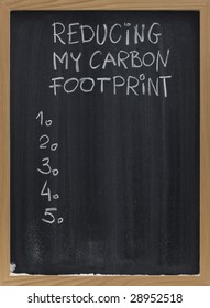 reducing my carbon footprint title and a blank numbered list of personal goals, actions or resolutions, handwritten with white chalk on blackboard with eraser smudges