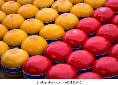 Red-Waxed export Edam cheese and yellow-waxed cheese for home sales at the Edam cheese market, Netherlands