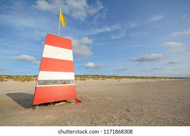 Red-white lifeguard tower on the beach of Henne Strand, Jutland Denmark Europe