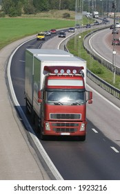 red/white truck, lorry on highway with traffic