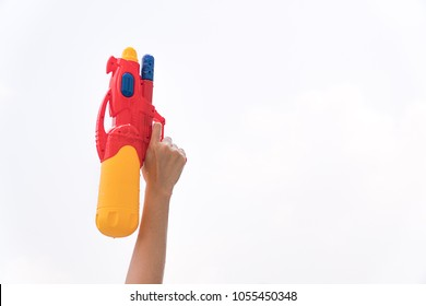 Red-Yellow Water Gun: Hold the water gun on the top. Concepcion Songkran Festival. White background.