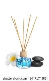 Reed air freshener, flower and spa stones on white background